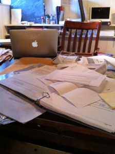 Desk cluttered with papers and files