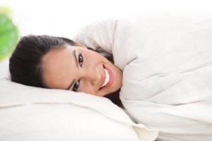 Woman sleeping on clean sheets
