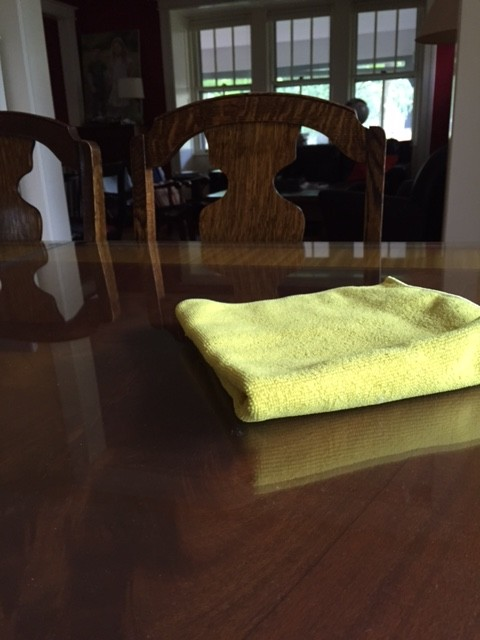 Yellow dust cloth on wood table